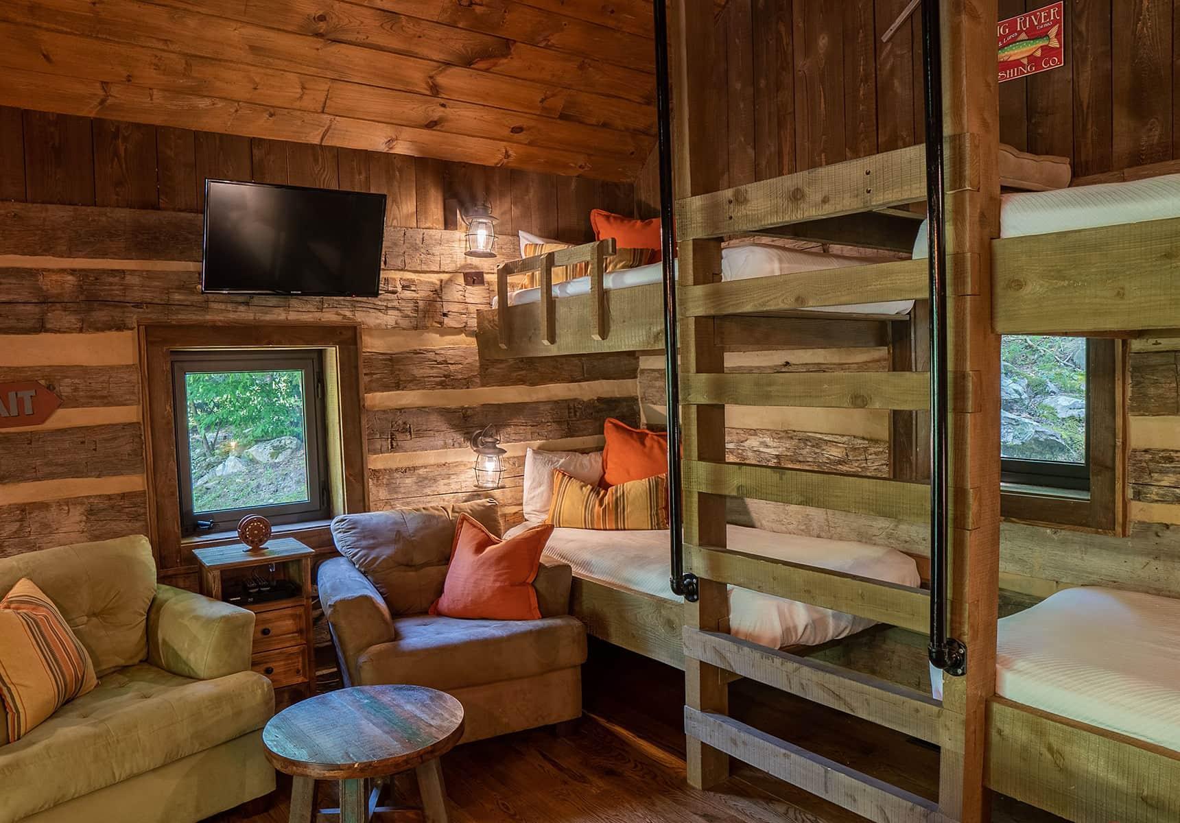 Fishing Creek Cabin seating area and bunks