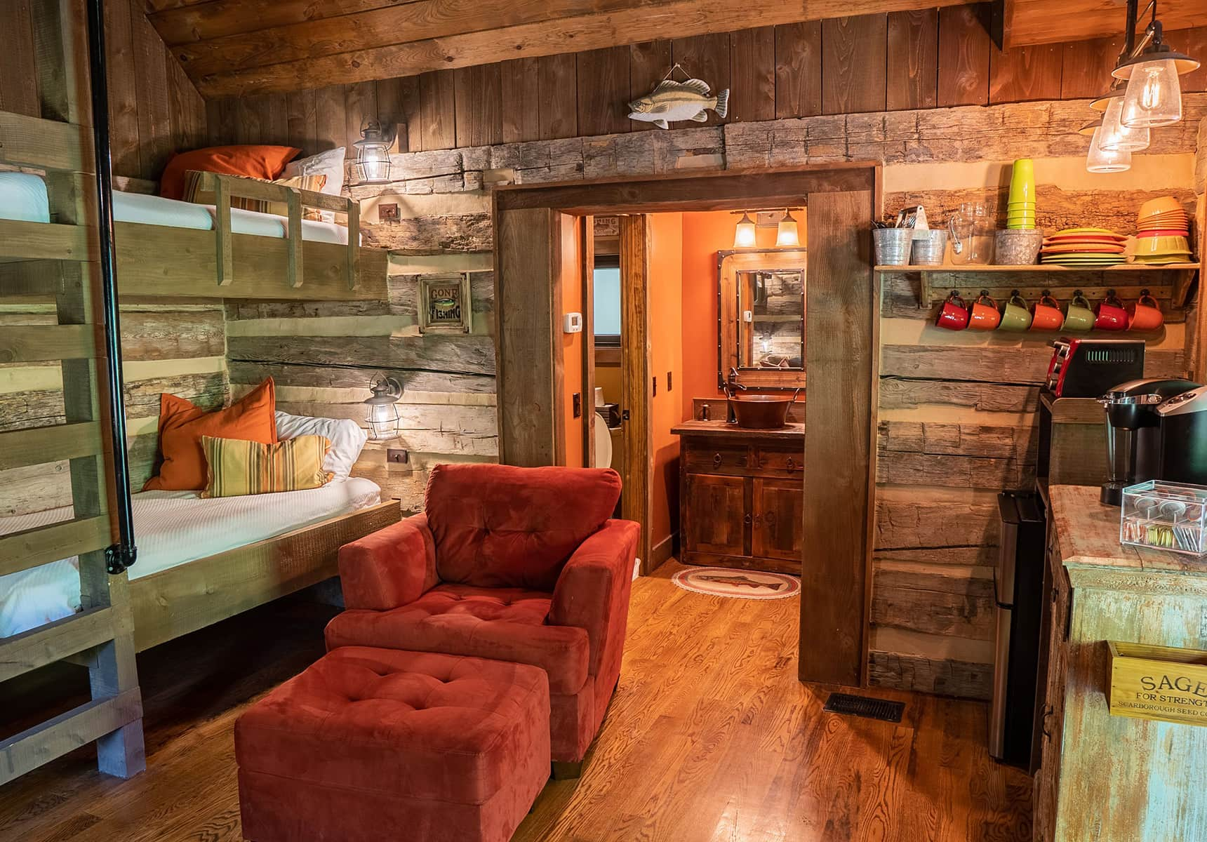 Fishing Creek Cabin interior with bunk beds and a doorway to the bathroom