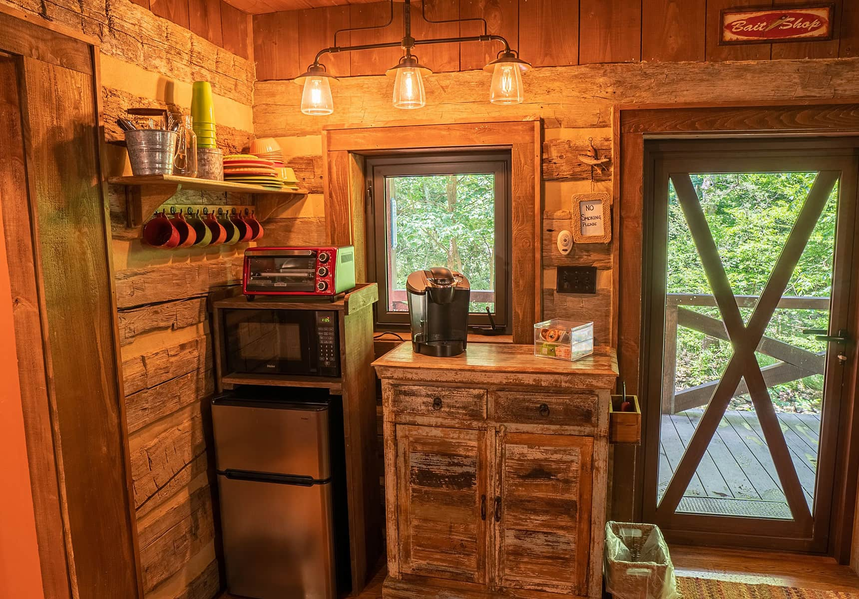 Fishing Creek Cabin kitchenette and door to the covered porch
