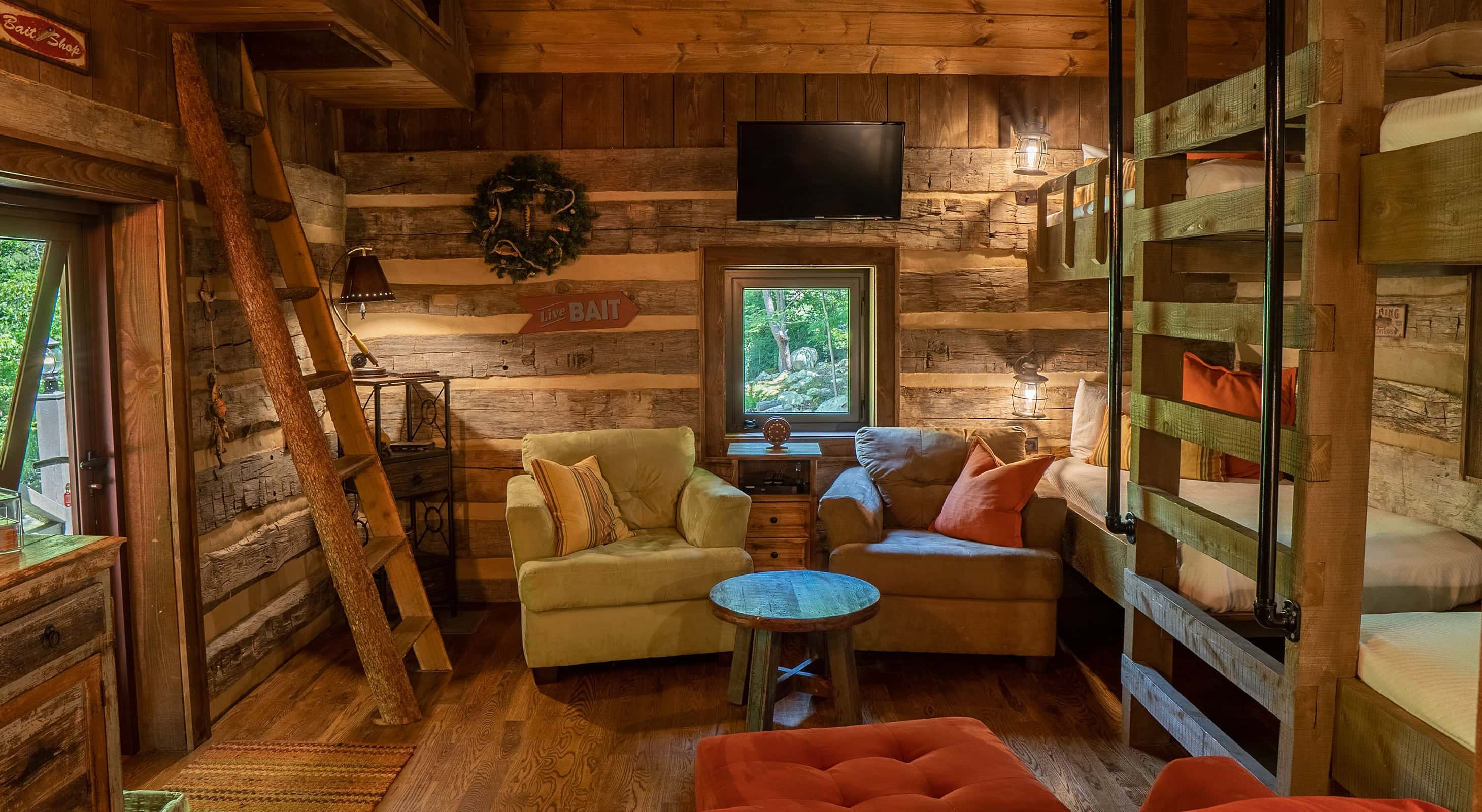 Fishing Creek Cabin interior with bunk beds and a seating area with a flatscreen TV