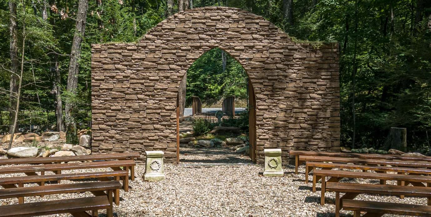 Exterior stone archway with worshiping benches set in front of it