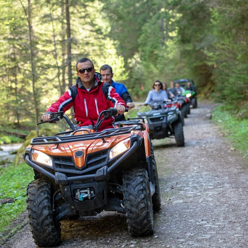A group of people on ATVs on a trail