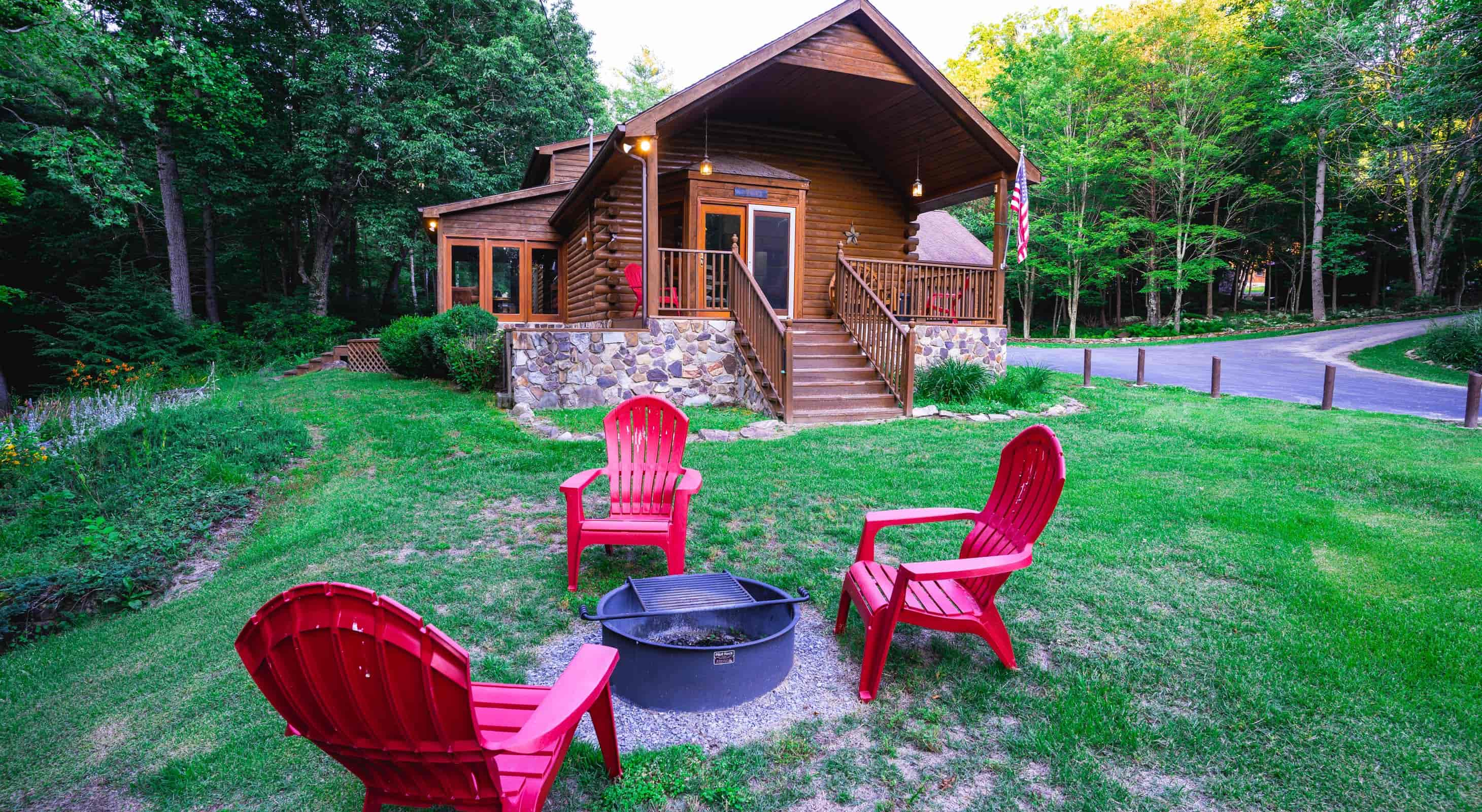 Creekside Home exterior Fire pit and chairs