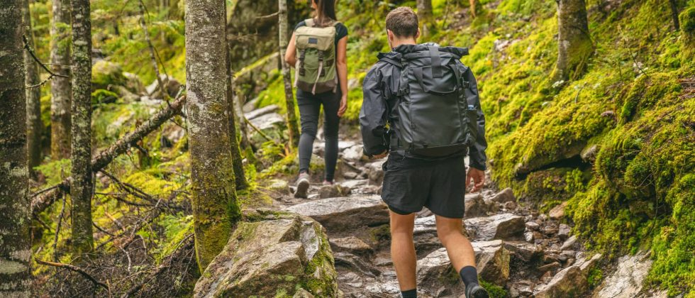 Couple hikes on a rocky forest trail