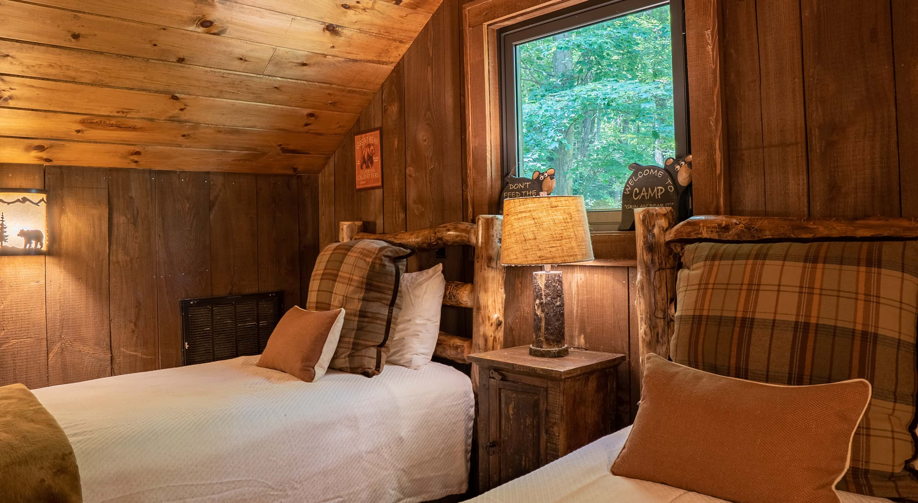 Two beds in the hunting cabin loft