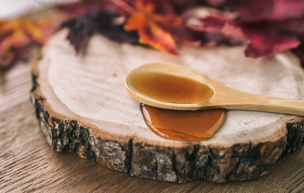 Maple syrup on a wooden spoon
